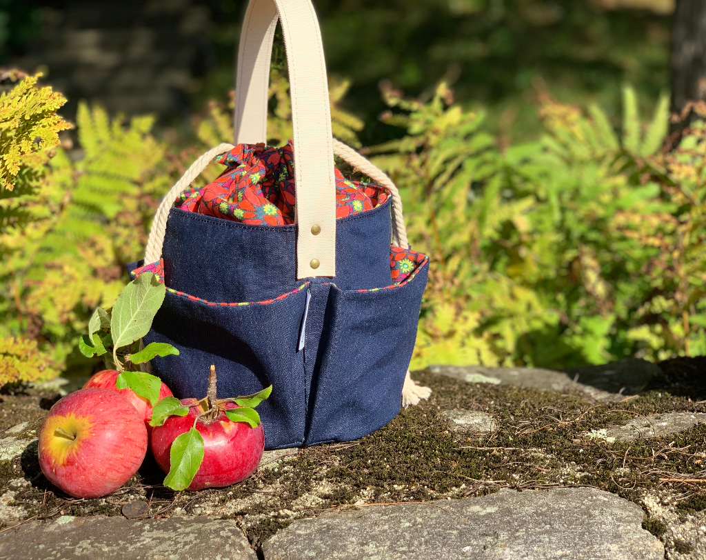 Lucky Penny Maker Tote in Denim with a woven handle and drawstring top.